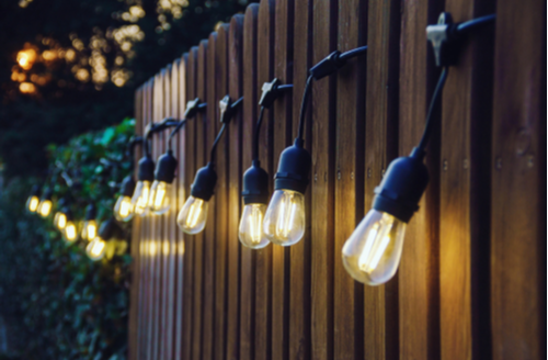 String lights on a fence