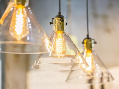 three edison bulbs in glass sconces